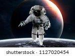 uranus with astronaut in front...   Shutterstock . vector #1127020454