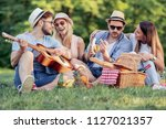 happy young friends having... | Shutterstock . vector #1127021357