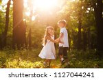 little brother and sister... | Shutterstock . vector #1127044241