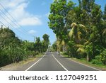 road through tropical forest ... | Shutterstock . vector #1127049251