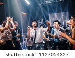 shot of a young man dancing in... | Shutterstock . vector #1127054327