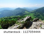 the rocky slope with view on... | Shutterstock . vector #1127054444