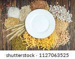 white plate and foods high in... | Shutterstock . vector #1127063525