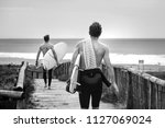Two Surfers Running With...