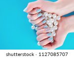 blue nails manicure on young... | Shutterstock . vector #1127085707