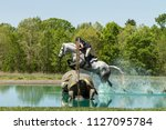 equestrian cross country water... | Shutterstock . vector #1127095784