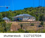 large house overlooking nelson... | Shutterstock . vector #1127107034