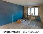 interior of a house under... | Shutterstock . vector #1127107664