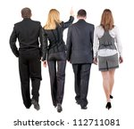 Small photo of back view of walking business team. group of businesspeople in suit going. woman pointing in distance. Rear view people collection. backside view of person. Isolated over white background.