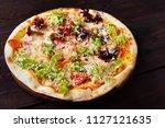pizza with lettuce ad garlic... | Shutterstock . vector #1127121635