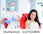 young girl dentist in mask with ... | Shutterstock . vector #1127123834