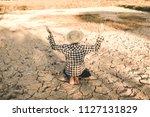 sad farmer on the cracked dry... | Shutterstock . vector #1127131829