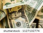 wad of dollar bills on a table   Shutterstock . vector #1127132774