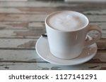 white fresh milk mug on wooden... | Shutterstock . vector #1127141291