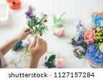 florist's creative work... | Shutterstock . vector #1127157284