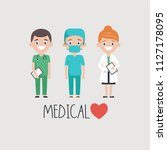cheerful male and female medics ... | Shutterstock .eps vector #1127178095