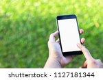 smartphone in man's hands. view ...   Shutterstock . vector #1127181344