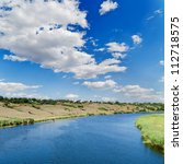 clouds over river - stock photo