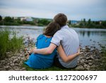 young couple walking in a... | Shutterstock . vector #1127200697