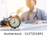 clock on doctor clinic table... | Shutterstock . vector #1127201891