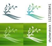 abstract tree concept logo.   Shutterstock .eps vector #1127203841