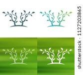 abstract tree concept logo.   Shutterstock .eps vector #1127203865