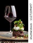 a large piece of juicy steak... | Shutterstock . vector #1127239697