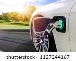 ev car or electric car at... | Shutterstock . vector #1127244167