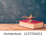 magic genie lamp and old book... | Shutterstock . vector #1127256221
