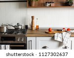 wooden board with knife ... | Shutterstock . vector #1127302637