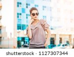 portrait of a young pretty... | Shutterstock . vector #1127307344