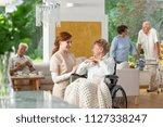 seniors in a luxury living room ... | Shutterstock . vector #1127338247