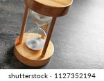 hourglass with flowing sand on... | Shutterstock . vector #1127352194
