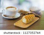 bread on wood with cup of... | Shutterstock . vector #1127352764