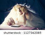 young woman in glasses lying on ... | Shutterstock . vector #1127362085