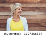 pretty mature blond woman with... | Shutterstock . vector #1127366894