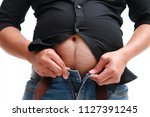 obese man in jeans squeeze the...   Shutterstock . vector #1127391245