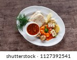 grilled fish fillet served with ... | Shutterstock . vector #1127392541