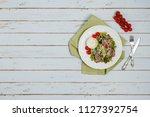 salad from roast beef served on ... | Shutterstock . vector #1127392754