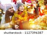 smiling girl with boy choosing... | Shutterstock . vector #1127396387