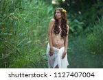 beautiful nude young woman on... | Shutterstock . vector #1127407004