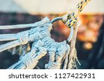 a knot of ropes and a ring....   Shutterstock . vector #1127422931