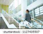 female worker on stairs in...   Shutterstock . vector #1127435507