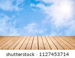 wood table top on sky... | Shutterstock . vector #1127453714