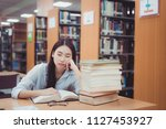 old book on the desk in... | Shutterstock . vector #1127453927