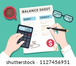 accountant with report and a...   Shutterstock .eps vector #1127456951