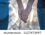 close up couple holding hands... | Shutterstock . vector #1127473997