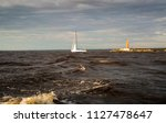 lighthouse  waves and yacht  in ... | Shutterstock . vector #1127478647
