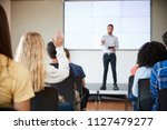pupil asking question during... | Shutterstock . vector #1127479277