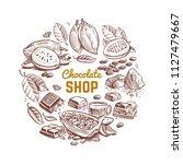 chocolate shop vector emblem... | Shutterstock .eps vector #1127479667